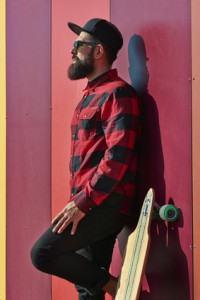 Young hipster man with a skateboard